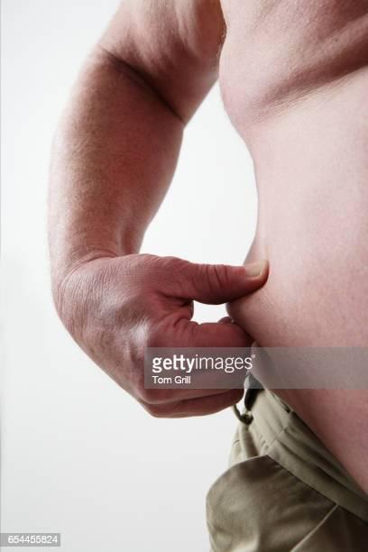 Overweight Man Pinching Love Handles