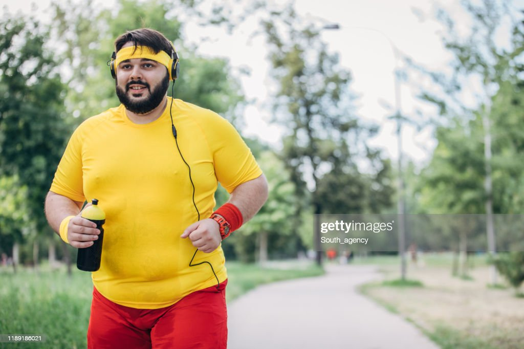 Overweight Man Running High Res Stock Photo Getty Images