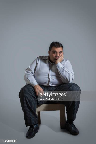 World S Best Fat Man Sitting Stock Pictures Photos And
