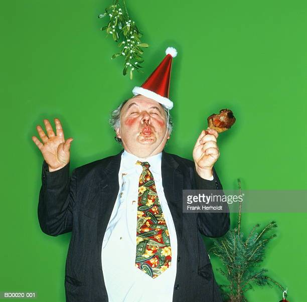 Overweight man standing under mistletoe, pouting (Enhancement)