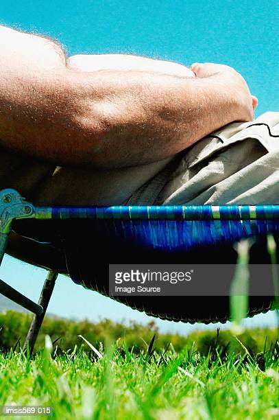 Overweight man sunbathing