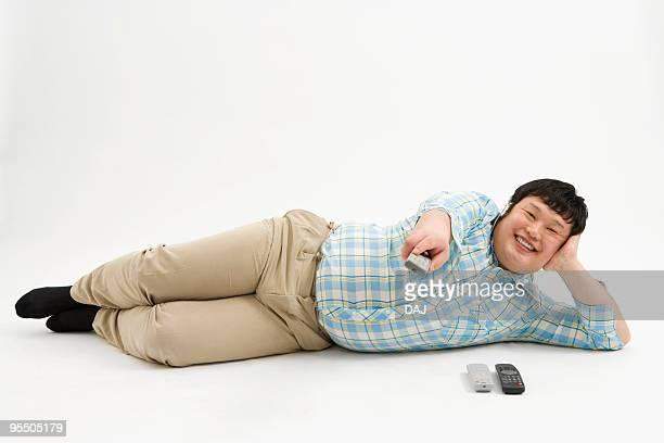 Overweight man watching TV