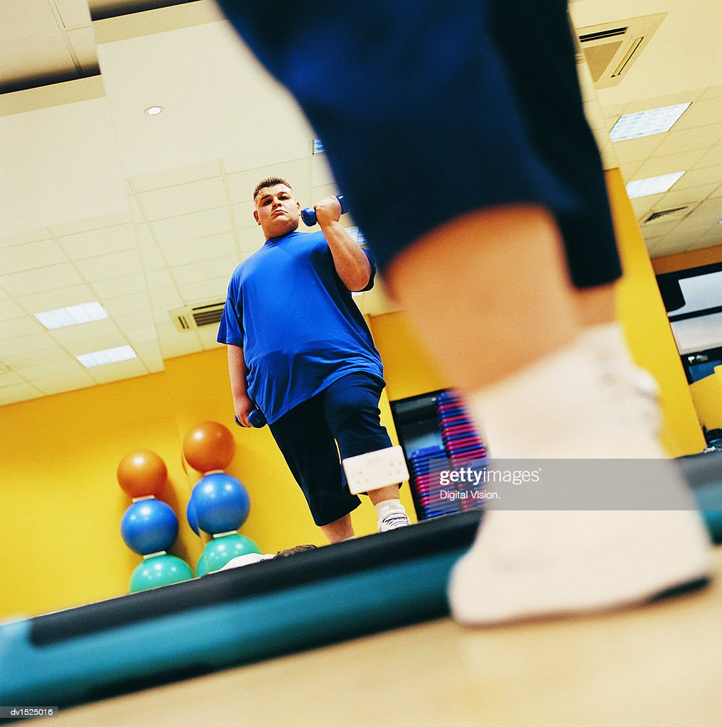 Overweight Man Weight Training in a Gym : Stock Photo
