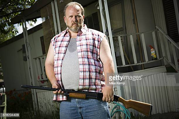 overweight man with a shotgun - redneck stock photos and pictures