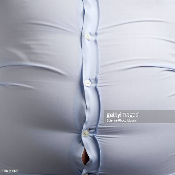 overweight man with bulging shirt buttons - abdomen stock pictures, royalty-free photos & images