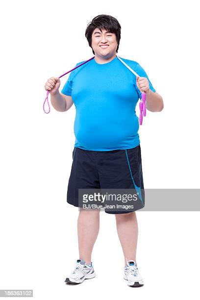overweight man with jumping rope - ランニングショートパンツ ストックフォトと画像