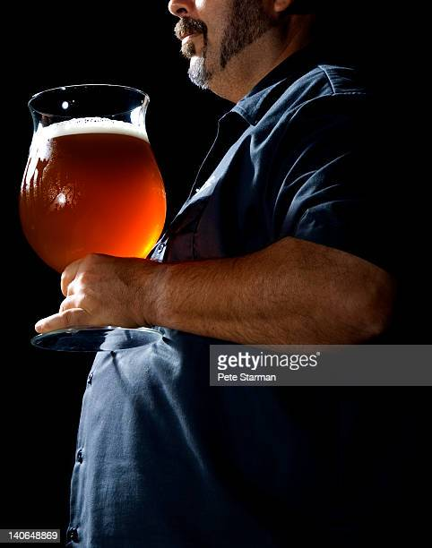 Overweight man with large beer.