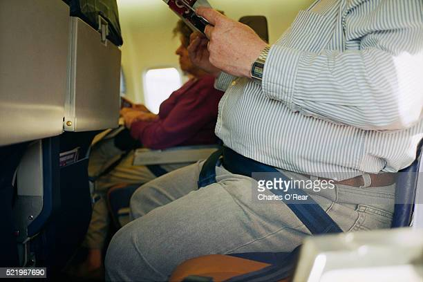Overweight Man's Stomach on Plane