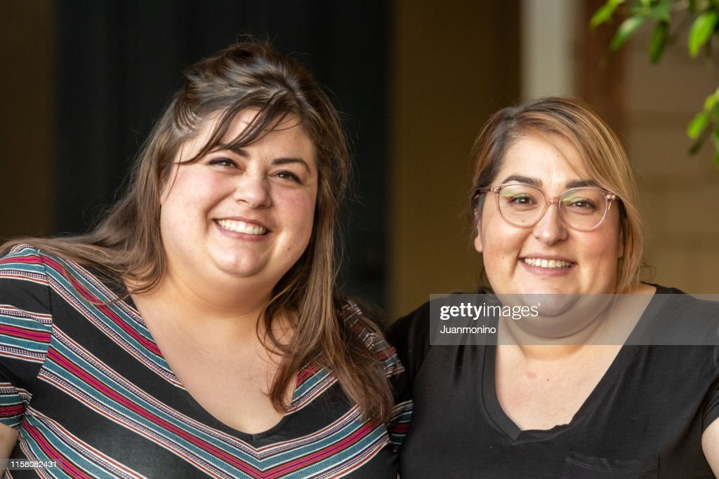Overweight Mid Adult Lesbian Couple Looking At The Camera ...