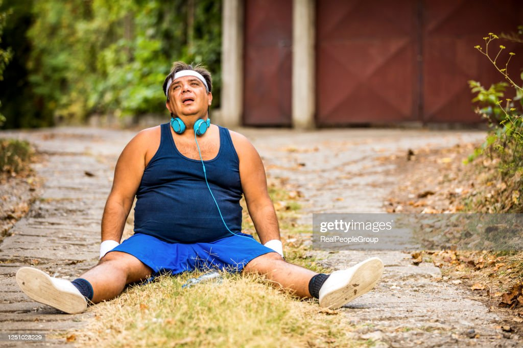 Overweight motivated man choosing healthy way of life, workout in park, weight loss : Stock Photo