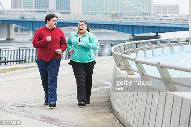 Overweight people exercising, walking, talking