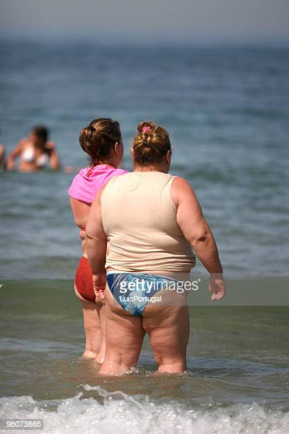 overweight - fat woman at beach stock photos and pictures