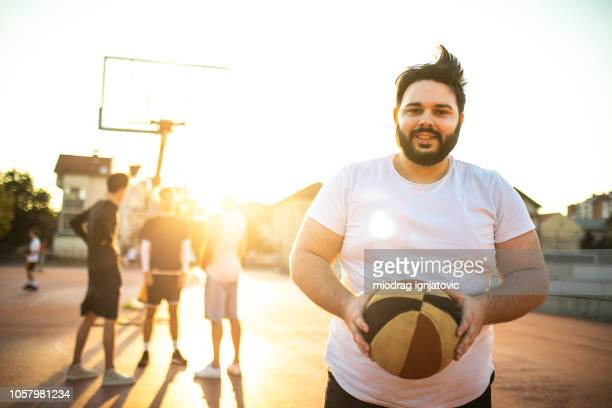 overweight play-maker being captain of today's basketball team - chubby stock pictures, royalty-free photos & images
