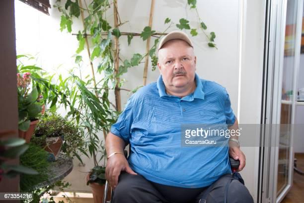 Overweight Senior Man Sitting on Wheelchair