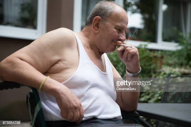 Fat Guy Smoking Stock Photos And Pictures