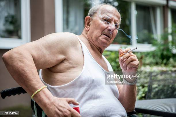 Overweight Senior Man Smoking Cigarette