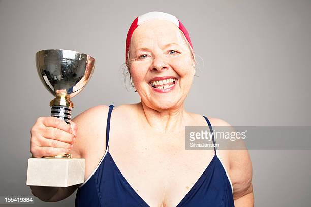 overweight senior woman winner swim trophy - fat old lady stock photos and pictures