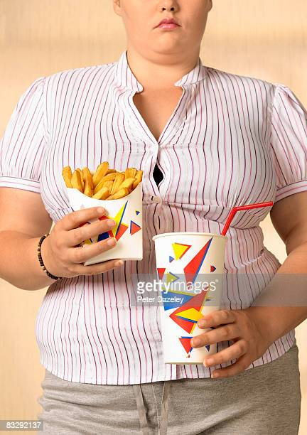 Overweight teenager with fries