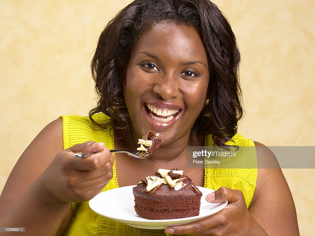 Fat Woman Eating Cake Stock Photos and Pictures Getty Images