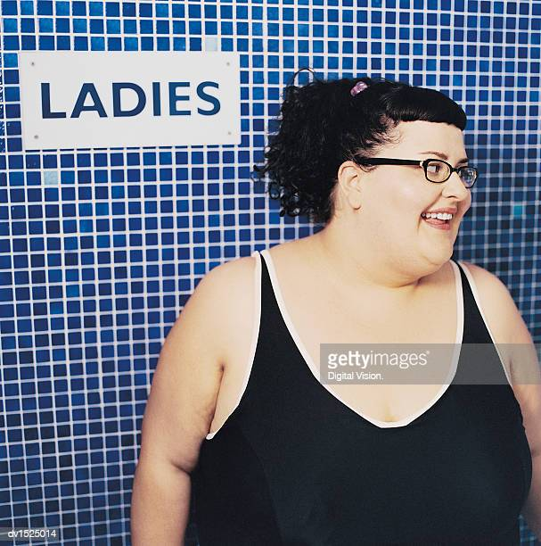 Overweight Woman in a Swimming Costume Outside a Changing Room