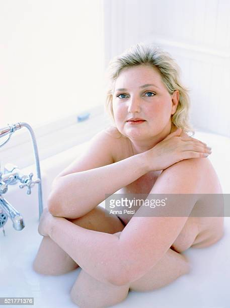 overweight woman in the bathtub - fat women in bath stock pictures, royalty-free photos & images