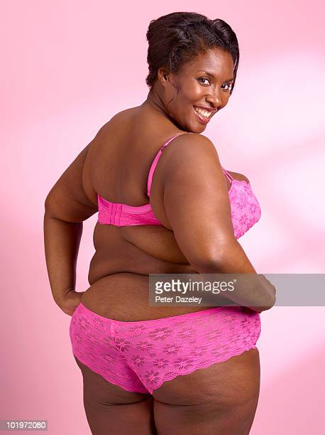 overweight woman on pink background - big bums stock photos and pictures