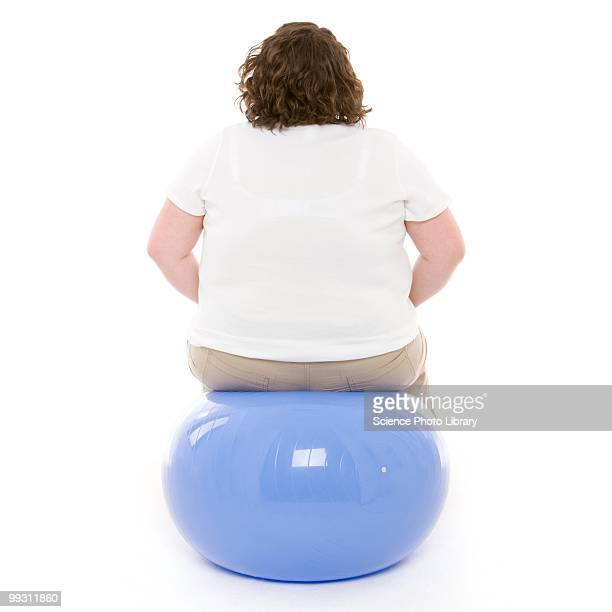 overweight woman - fat woman sitting on man stock pictures, royalty-free photos & images