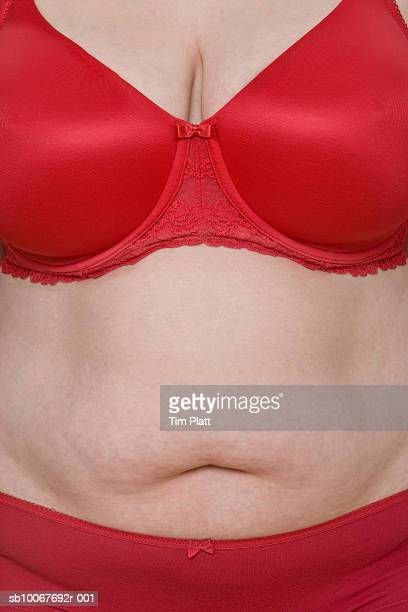 overweight woman wearing underwear, mid section - fat woman funny stock photos and pictures