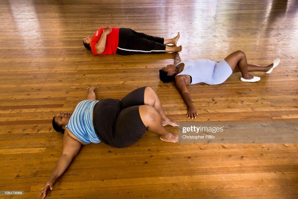 Overweight women exercising before dance rehearsal : Stock Photo
