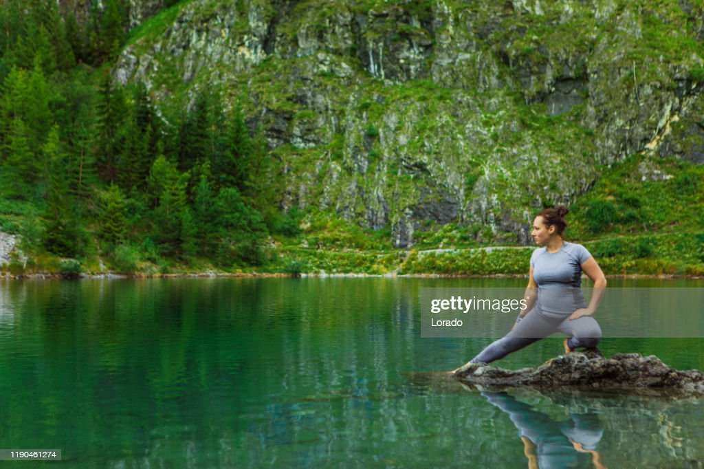 Overweight young woman during a workout in the alpine countryside : Stock Photo
