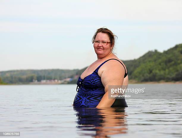 overwight woman bath - swimwear stock photos and pictures