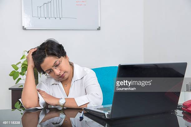 Overworked and Stressed out businesswoman, takes a break.