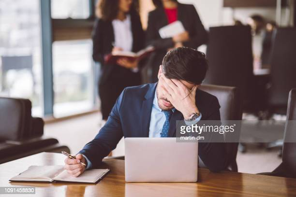 overworked businessman in the office - head in hands stock pictures, royalty-free photos & images