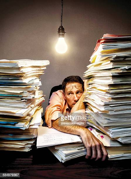 overworked businessman - overworked stock pictures, royalty-free photos & images