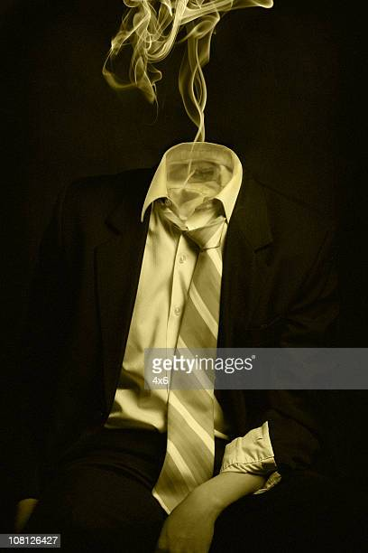 Overworked Businessman's Head Disappearing in Puff of Smoke