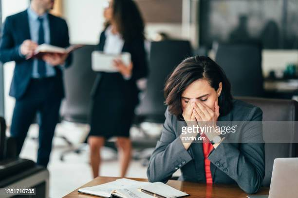 overworked businesswoman in the office - being fired photos stock pictures, royalty-free photos & images