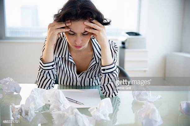 overworked businesswoman sitting at desk - veto stock pictures, royalty-free photos & images