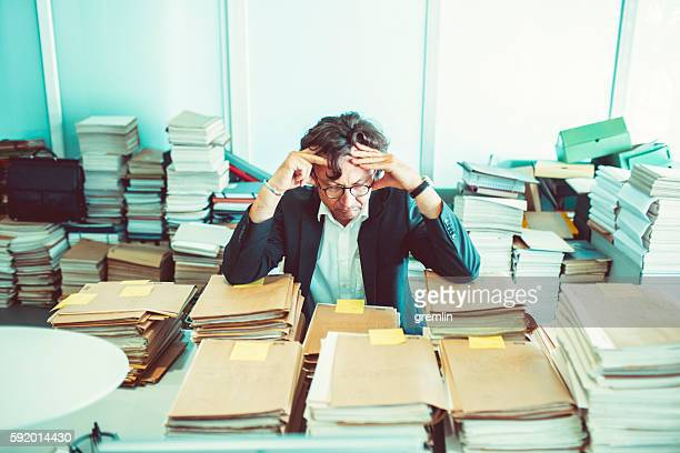 Overworked office worker, bureaucracy, archives