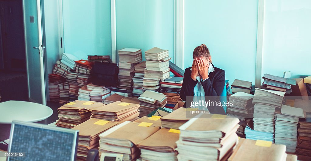 Overworked office worker, bureaucracy, archives : Stock Photo