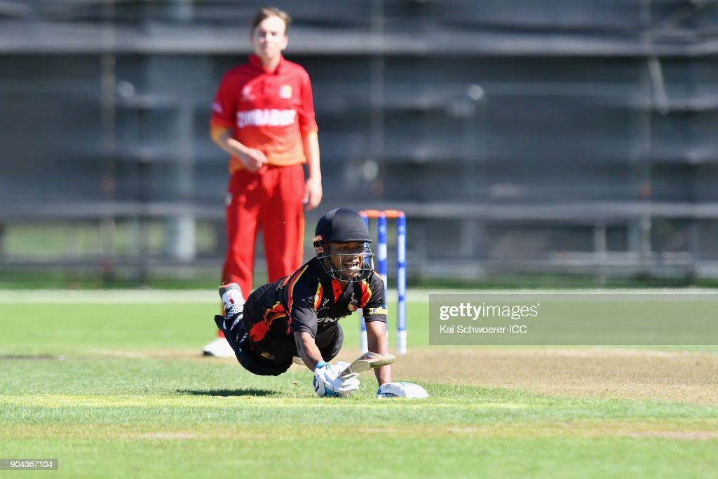 Ovia Sam of Papua New Guinea dives to save his wicket during the ICC U19 Cricket World Cup match between Zimbabwe and Papua New Guinea at Lincoln Green on January 13, 2018 in Christchurch, New Zealand.