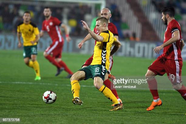 Ovidijus Verbickas of Lithuania passes the ball during international friendly match between Georgia and Lithuania at Mikheil Meskhi Stadium on March...