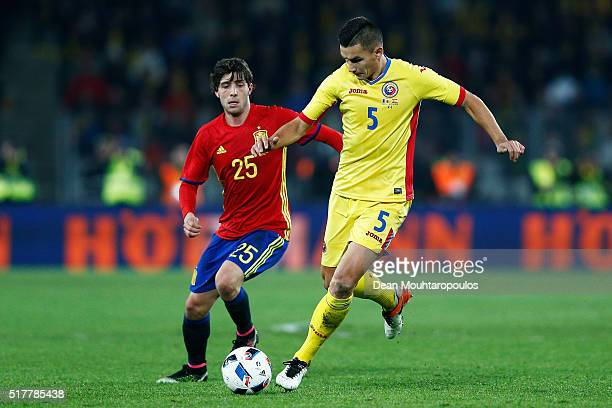 Ovidiu Hoban of Romania battles for the ball with Sergi Roberto of Spain during the International Friendly match between Romania and Spain held at...