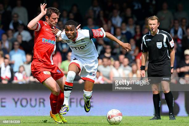 Ovidy Karuru of OH Leuven battles for the ball with Stephane Pichot of Mouscron during match day 1 of the Final Round in the second division match...