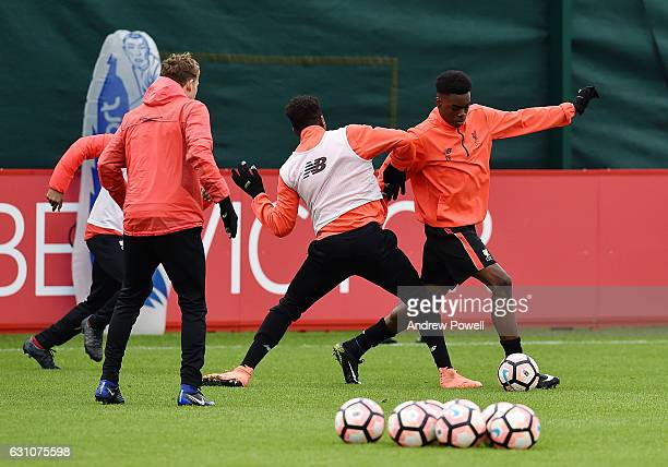 Ovie Ejaria and Divock Origi of Liverpool during a training session at Melwood Training Ground on January 6 2017 in Liverpool England