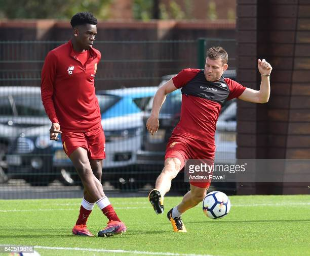 Ovie Ejaria and James Milner of Liverpool during a training session at Melwood Training Ground on September 4 2017 in Liverpool England