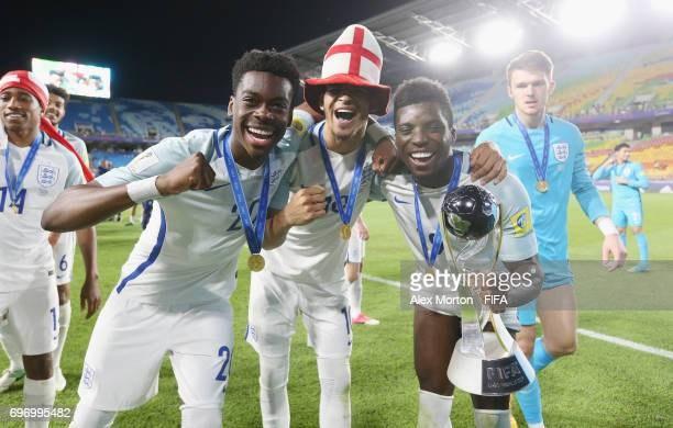 Ovie Ejaria Dominic Solanke and Sheyi Ojo of England celebrate with the trophy after the FIFA U20 World Cup Korea Republic 2017 Final match between...
