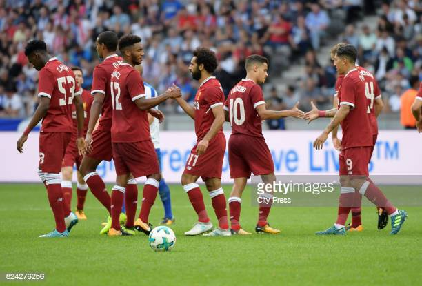 Ovie Ejaria Joe Gomez Mohamed Salah Philippe Coutinho and Roberto Firmino of Liverpool FC celebrate after scoring the 03 during the test match...