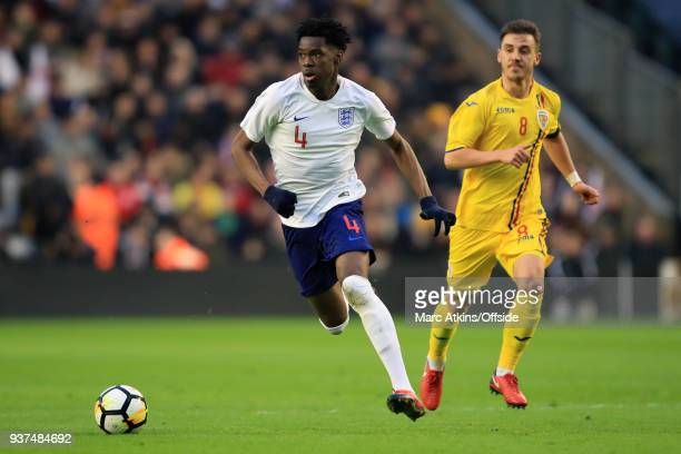 Ovie Ejaria of England in action with Razvan Oaida of Romania during the U21 International Friendly match between England U21 and Romania U21 at...