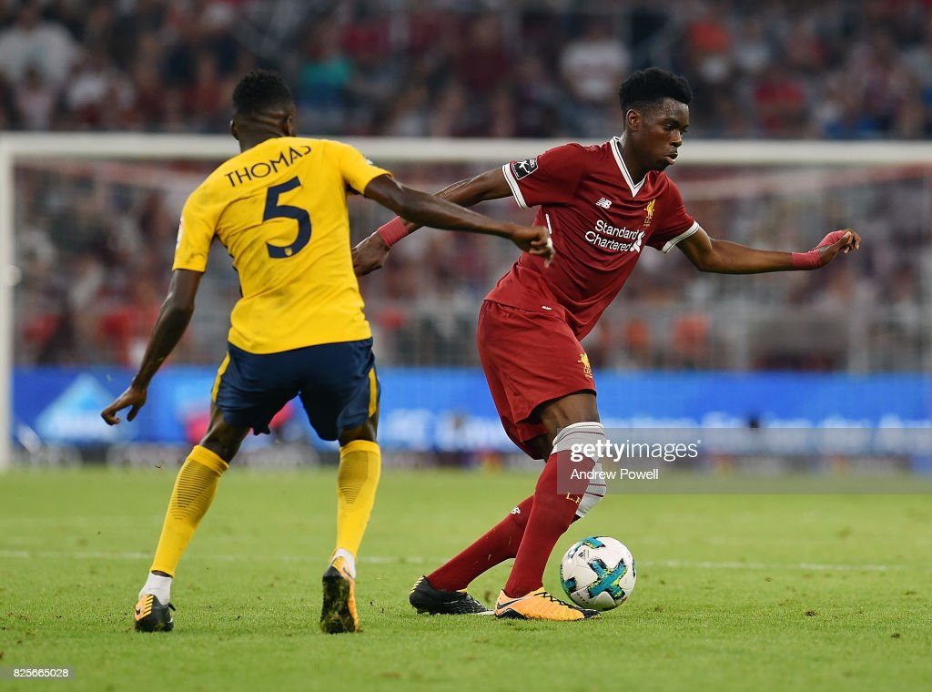 Ovie Ejaria of Liveprool competes with Thomas Partey of Atletico Madrid during the Audi Cup 2017 match between Liverpool FC and Atletico Madrid at Allianz Arena on August 2, 2017 in Munich, Germany.