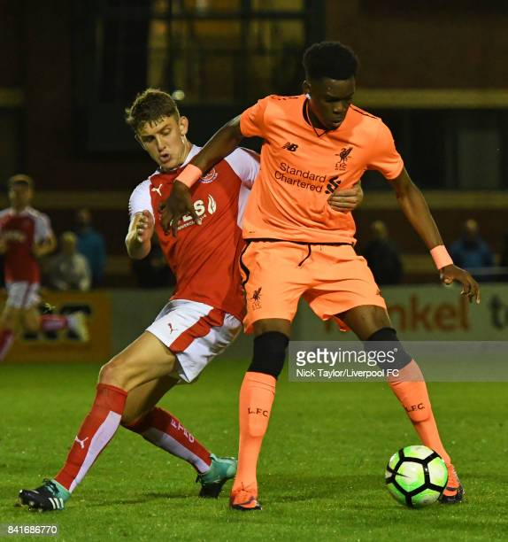 Ovie Ejaria of Liverpool and Harrison Biggins of Fleetwood Town in action during the Molson Coors Senior Cup Final at The County Ground on September...
